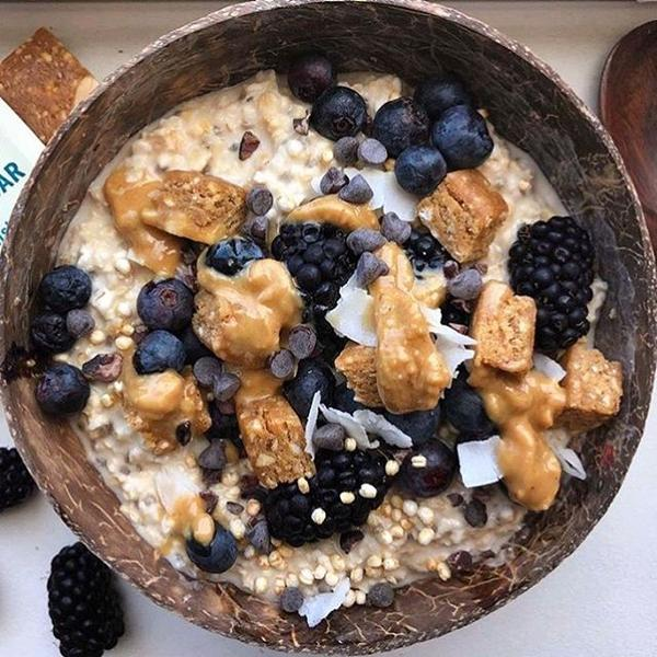 We  the way @datesandfigs topped her delicious oat bowl. Lots of berries, pb & big big MacroBar chunks!  . . Comment  if youd like a bite! . #bowls#coconutbowls#pb#breakfastbowl